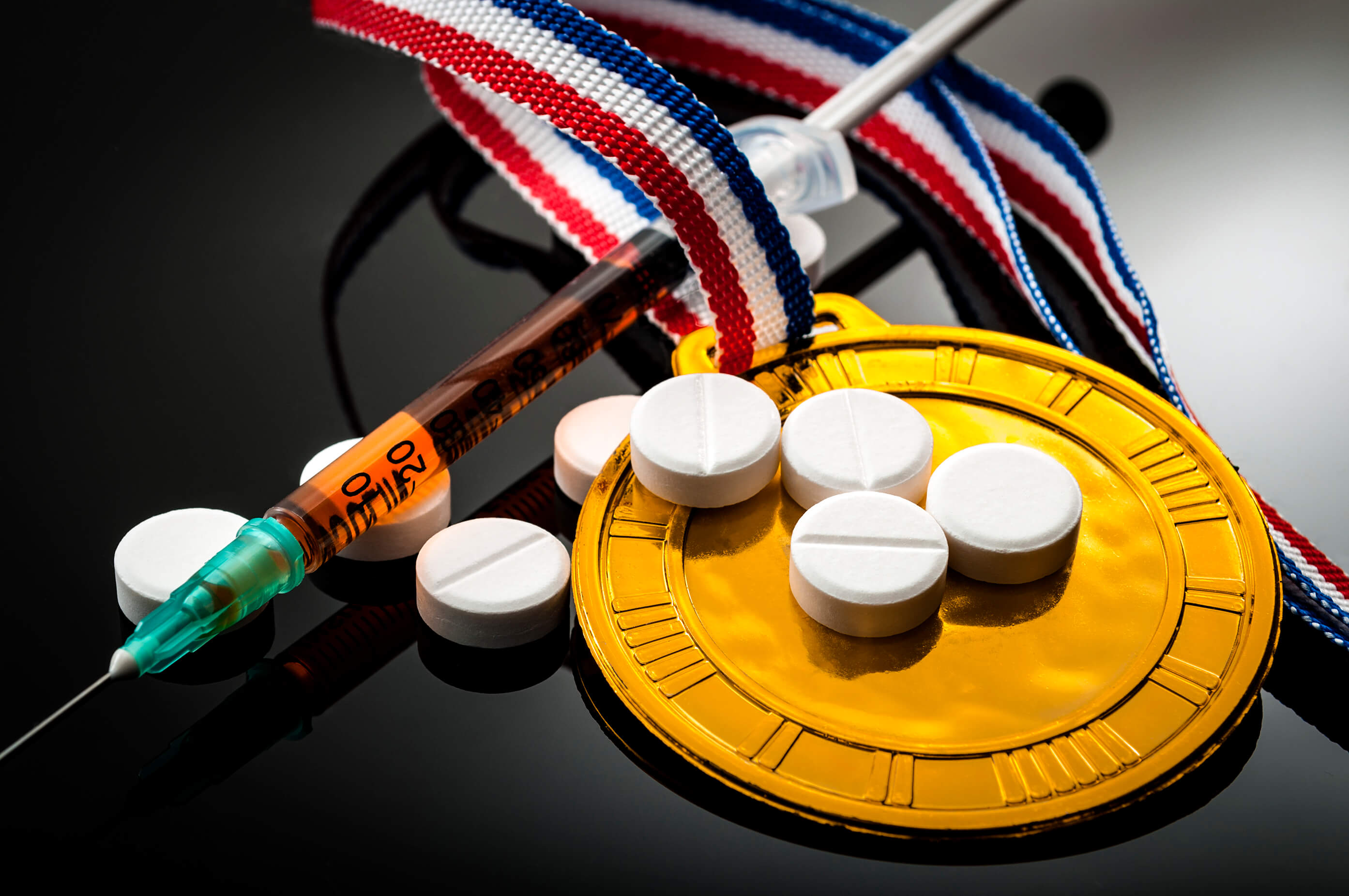 Athletes medal, pills and dope injection