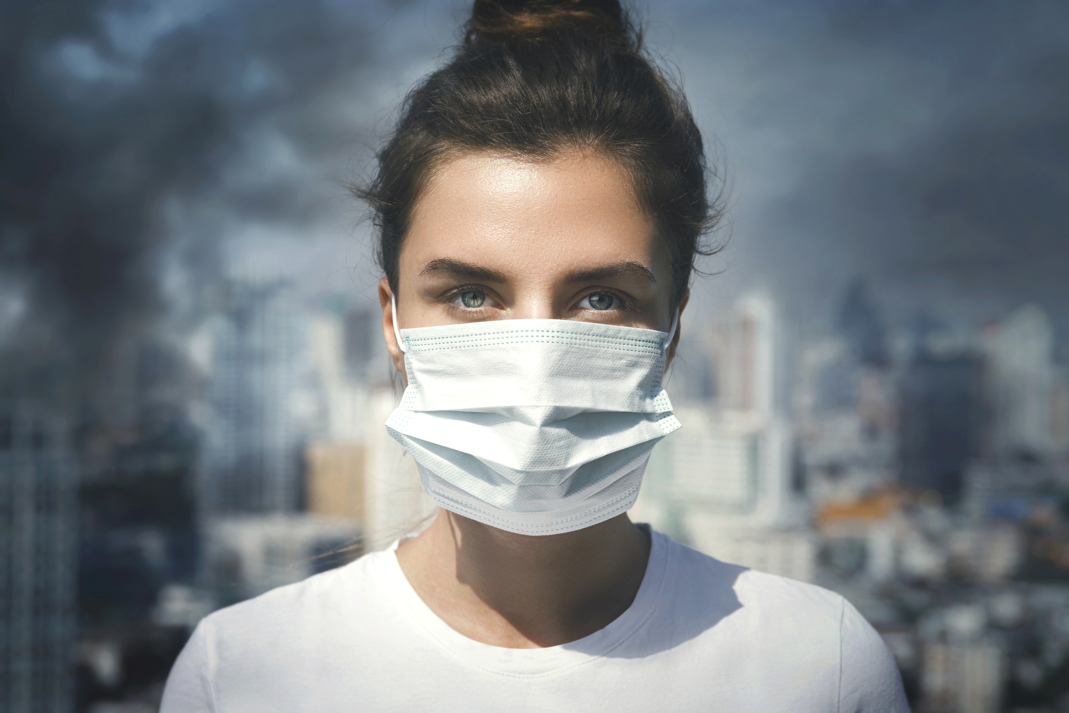 Lady in mask due to pollution
