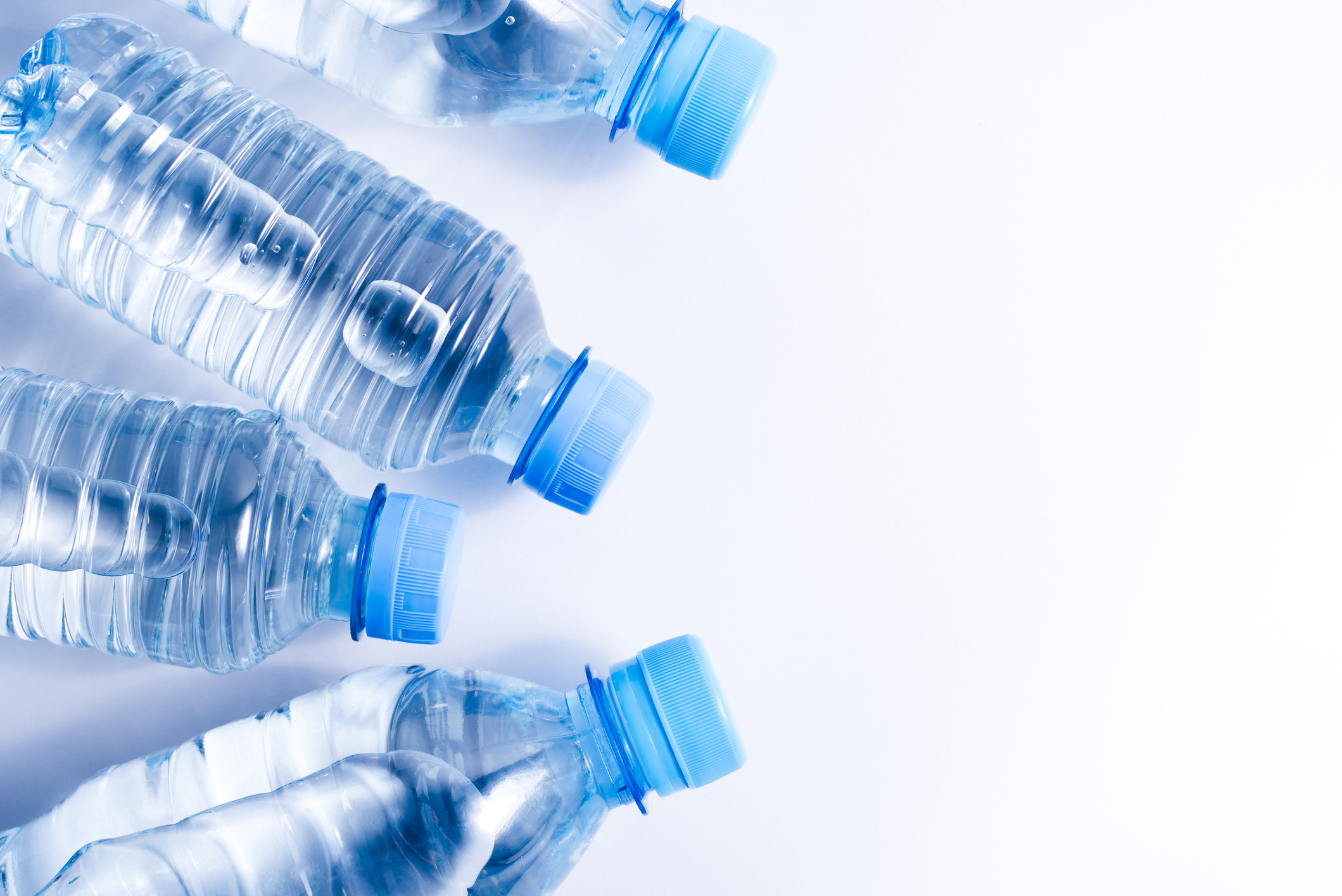 Several drinking water bottles on white background