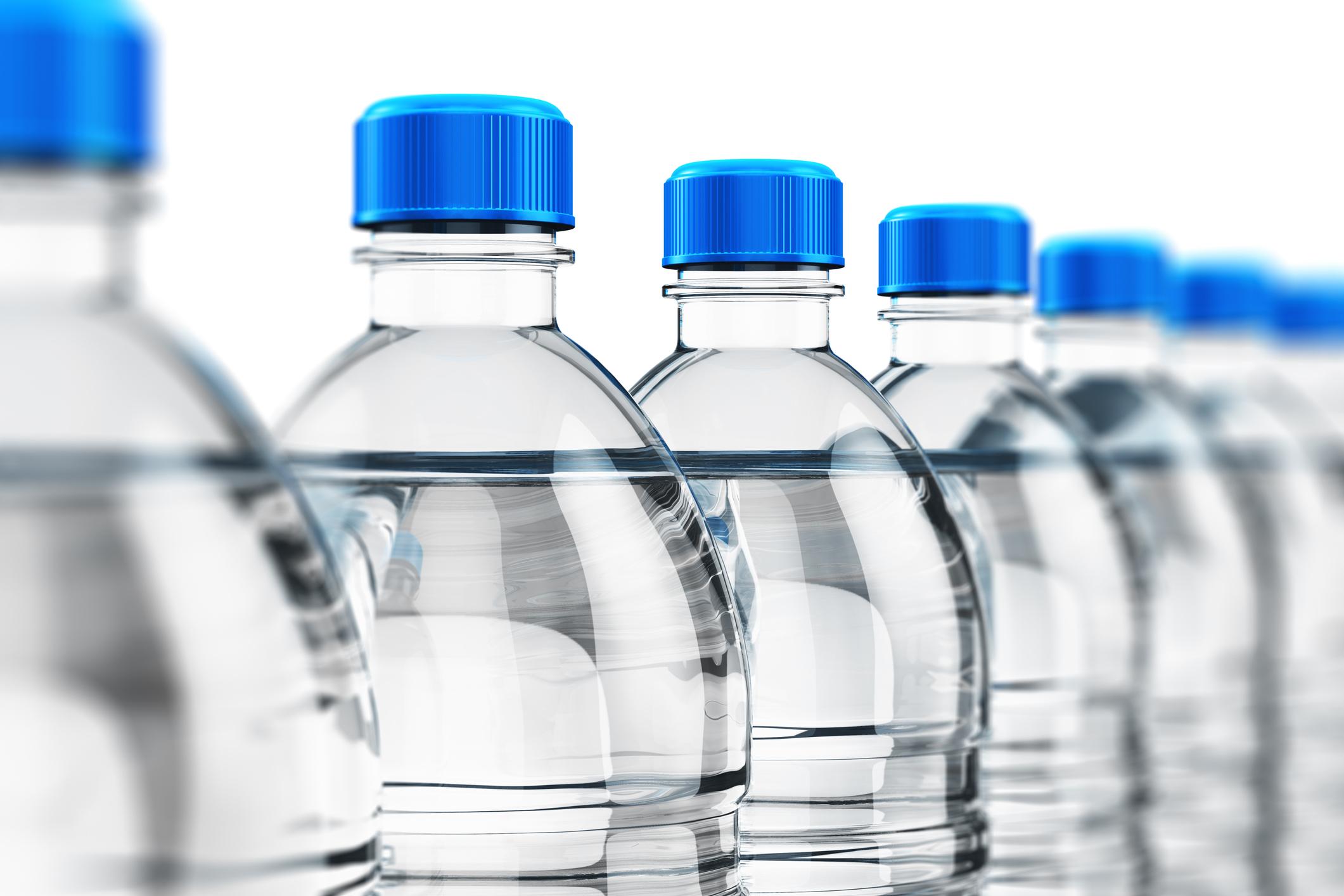 Row of plastic drink water bottles