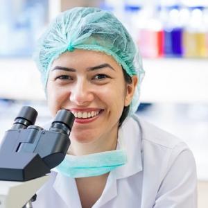 Microscope Scientist using ultrapure water