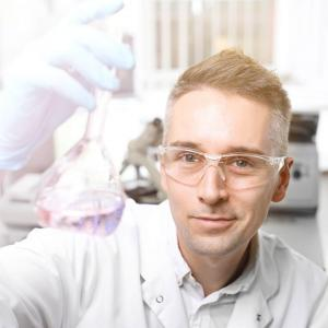 Lab man and test tube with solution
