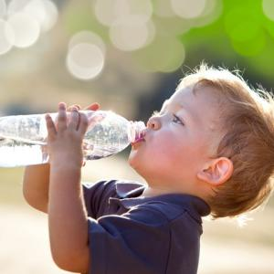 Child drinking water to be healthy